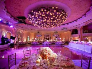 Lighting in pink and purple colors with aesthetically decorated banquet hall.