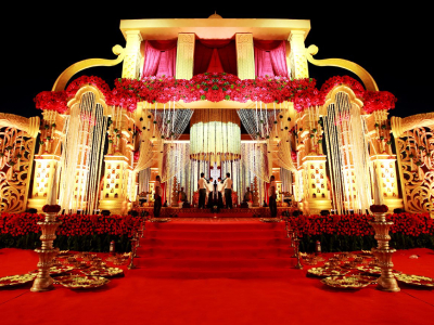 Bright Shade of Red Color Theme Wedding Hall Decoration with Beautiful Lightings.