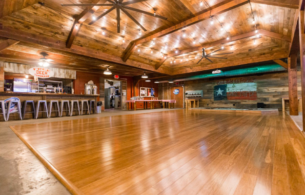 A wooden dance floor arranged for a party at a banquet hall.