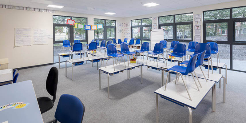 An Image Representing The Modern Classroom Interior With Empty Classroom Benches, Desks And Chairs.