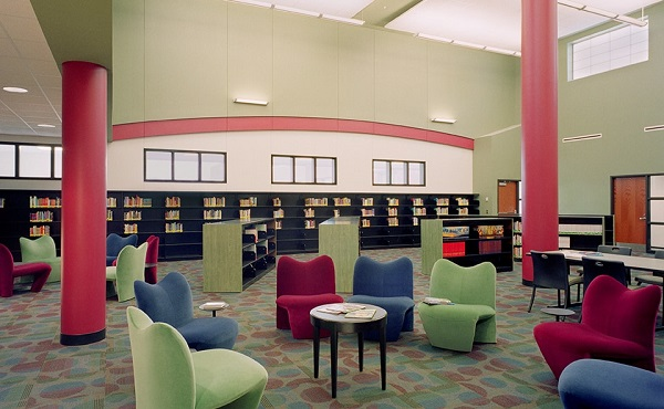 Interior Photography of The Library With Empty Seating In The Foreground In The Modern School.